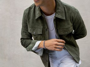Model Tyler Joe wears pieces from the new Mejuri men's collection.