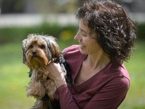 B.C. SPCA Shuswap manager Victoria Olynik relaxes with a small dog who seems just a little wary of the camera. Animal advocates say if you do decide to adopt, take on a rescue animal whenever possible.