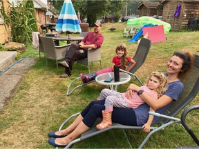 """""""It's great. We've got the green space. And everybody makes jam with the blackberries,"""" says Spencer Dill. The military families that continue to live on the spacious Jericho Lands have been told they can stay until 2023. (From left Spencer Dill, Emma Dill, Evera Dill, Erin Dill)"""