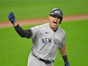 Gio Urshela of the New York Yankees celebrates after hitting a grand slam during Game 2 of the American League Wild Card Series at Progressive Field on Sept. 30 in Cleveland, Ohio.