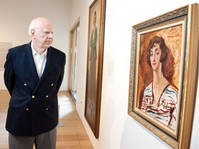 Michael Audain poses with a 1927 portrait of his mother, Madeline Stulik by the English painter Augustus John, in this 2016 photo. Audain is the chair of the Audain Foundation, which is this year awarding its prize to 12 artist-run centres instead of a single prominent artist.