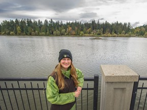 Conservation projects manager Ariane Comeau in front of Lost Lagoon, where more invasive species of fish like carp and three-spined stickleback have been able to survive in warmer water.