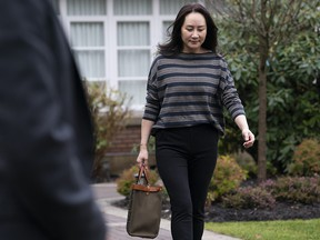 Chief financial officer of Huawei, Meng Wanzhou, leaves her home in Vancouver on Wednesday, Nov. 25, 2020. Wanzhou is heading to the British Columbia Supreme Court for an evidentiary hearing in her extradition case.
