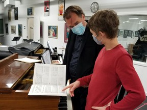Conductor Leslie Dala and his son Andreas rehearse for Amahl and the Night Visitors.