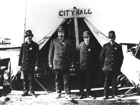 After the fire of 1886, the Vancouver Police Department poses in front of the makeshift city hall at Carrall and Water Streets, which doubled as the police station. (left to right) Cons. Jackson T. Abray, Chief J.M. Stewart, V.W. Haywood, and Deputy Chief John McLaren. Vancouver Archives LGN 457
