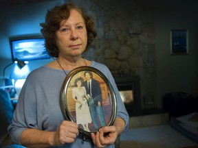 Bronwyn James with wedding photo of her and husband, Doug Fung. Eric Hamber teacher Fung died of COVID-19 in October.
