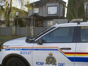 An RCMP cruiser sits in front of a home on Oxford Street in Burnaby on Tuesday.
