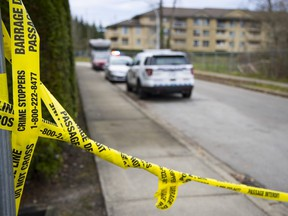 Homicide investigators on the scene in Surrey on Dec. 3, 2020 of a fatal shooting earlier that day, in which a woman died in her vehicle in the alleyway of the 13700-block of 75A Avenue.