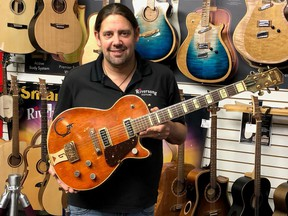 Mike Miltimore says the Gretsch electric guitar that a woman brought into his store is from 1955 and similar to one played by country music legend Chet Atkins before he developed his signature series of guitars.