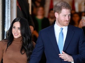 Britain's Prince Harry and his wife Meghan, Duchess of Sussex, leave Canada House in London, England, Jan. 7, 2020.