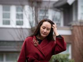 Meng Wanzhou, chief financial officer of Huawei, leaves her home to attend a hearing at B.C. Supreme Court, in Vancouver, on Friday, December 11, 2020.