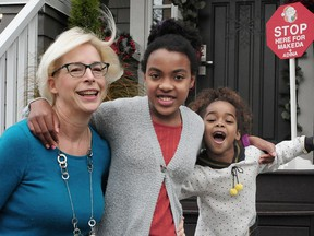 Makeda Insley, 13, (centre) recently discovered she has fatal neuro-degenerative disease called aspartylglucosaminuria. She is pictured with her mother Barbara and sister Adina.
