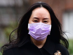 In this file photo taken on January 12, 2021, Huawei Chief Financial Officer, Meng Wanzhou, leaves her Vancouver home to attend British Columbia Supreme Court.
