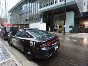 Vancouver Police on scene at Telus Gardens at 777 Richards St. in Vancouver on Sunday.