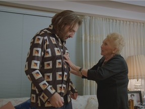 Director Daniel Schubert is seen here in his film Martha getting something fashion advice from his grandmother Martha Katz. The 21-minute movie is about Holocaust survivor Martha who lost both her parents and two younger siblings to the Nazis. Photo credit: Courtesy of the National Film Board of Canada.