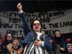 Wet'suwet'en supporter Leah Melville chants with protesters on the steps of legislature before the throne speech in Victoria, on Tuesday, February 11, 2020.