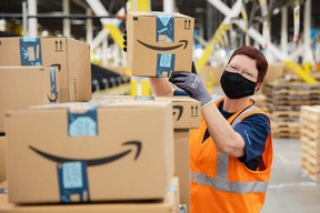 Amazon associates working to deliver smiles to customers during the 2020 holiday season at the Tsawwassen fulfillment centre where orders are picked, packed and shipped.