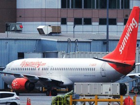 A Sunwing plane sits at Vancouver International Airport (YVR) as four of Canada's major airlines have suspended service to Mexico and the Caribbean , in Richmond on January 31, 2021.