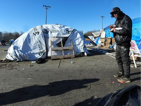 Taze Haasbeek outside his tent at Strathcona Park as temperatures are expected to drop to -10c overnight  in Vancouver.