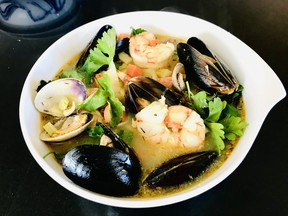 The bouillabaisse kit for two from f.i.s.h. is generously endowed with mussels, clams, halibut, salmon and prawns in a halibut saffron broth.