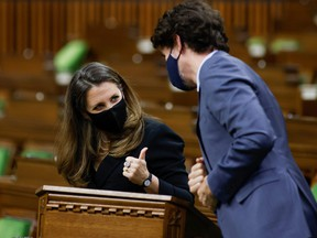 Finance Minister Chrystia Freeland gives a thumbs up to Prime Minister Justin Trudeau in the House of Commons.