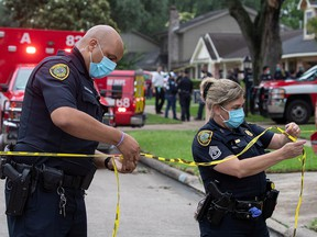 Police officials cordon off a street in southwest Houston, Texas, April 30, 2021.