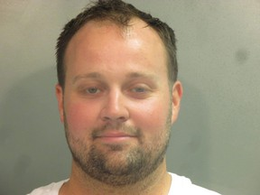 """In this handout photo provided by the Washington County Sheriff's Office, former television personality on """"19 Kids And Counting"""" Josh Duggar poses for a booking photo after his arrest April 29, 2021 in Fayetteville, Ark."""