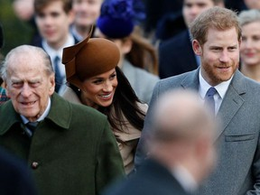 In this file photo taken on December 25, 2017 (L-R) Britain's Prince Philip, Duke of Edinburgh, US actress and fiancee of Britain's Prince Harry Meghan Markle and Britain's Prince Harry (R) arrive to attend the Royal Family's traditional Christmas Day church service at St Mary Magdalene Church in Sandringham, Norfolk, eastern England.