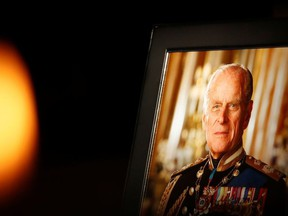 A picture of Britain's Prince Philip rests on a memorial at Sheffield cathedral, in Sheffield, Britain, April 13, 2021.