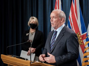 'This is not the time to load up the Winnebago and travel around British Columbia,' said Premier John Horgan.