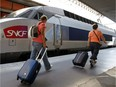 People prepare to board a high-speed train at the Gare St-Charles station in Marseille, southern France.