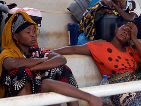 Women sit inside a displacement centre after fleeing an attack claimed by Islamic State-linked insurgents on the town of Palma, in Pemba, Mozambique, on April 2, 2021.