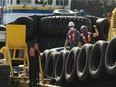 Tugboat workers in Vancouver on March 31, 2021. Some marine stakeholders are calling on Transport Canada to improve the safety regulations governing small vessels after two men died when a tugboat sank near Kitimat in February.