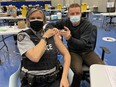Surrey RMCP Sergeant Elenore Sturko get her first COVID-19 vaccine as Surrey front-line workers are being given priority because their city is a COVID hot spot.
