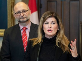 Justice Minister David Lametti listens as former Conservative MP Rona Ambrose speaks about a bill on sexual assault law training for judges, Feb. 4, 2020 on Parliament Hill.