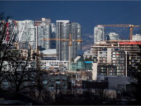"""""""I really don't know what to say when our federal government admits that it has made housing in Canada better for foreign investors than for Canadians. Who are they serving? Clearly not Canadians,"""" says real-estate analyst John Pasalis. (Photo Construction cranes in Vancouver)."""