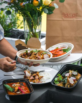 A selection of curries and other Thai dishes available for takeout. .