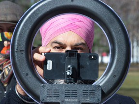 NDP Leader Jagmeet Singh adjusts his webcam prior to a news conference on March 29, 2021, in Montreal.