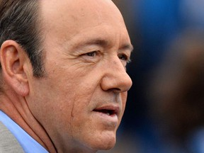 In this file photo taken on June 12, 2013 US actor Kevin Spacey watches as France's Nicolas Mahut plays Scotland's Andy Murray during their ATP Aegon Championships tennis match at the Queen's Club in west London.