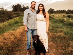 Emily and Steven McManus and their dog Duke are shown in a handout photo after they were engaged in 2019. They had a small wedding ceremony with a few guests in 2020 but Emily didn't wear her wedding dress and hopes to do that on her big day in front of lots of guests in July 2022 after twice cancelling wedding dates due to the pandemic.