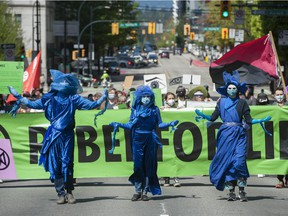 Several dozen supporters of the environmental group Extinction Rebellion occupy the intersection of Granville and Georgia Streets in Vancouver, B.C. Saturday, May 1, 2021. The event kicks-off five days of 'Spring Rebellion' by the group who are calling for changes to society's attitudes toward the environment.