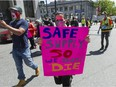 Several dozen protestors march through the Downtown Eastside of Vancouver, BC Tuesday, May 11, 2021 calling for a safe supply of street drugs.