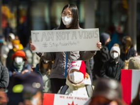 Protesters at an anti-Asian hate rally outside the Vancouver Art Gallery in late March. Independent B.C. Senator Yuen Pau Woo says there has been a 'deafening silence' on the reasons for the recent rise in anti-Asian racism.