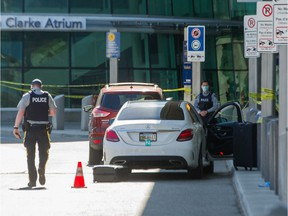 Police investigate a shooting at YVR in Richmond, BC, May 9, 2021. Photo by Arlen Redekop / Vancouver Sun / The Province (PNG) (story by Kim Bolan) [PNG Merlin Archive]