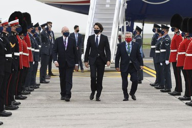 Canadian Prime Minister Justin Trudeau, (C), arrives ahead of the G7 meeting at Cornwall airport on June 10, 2021 in Newquay, England.