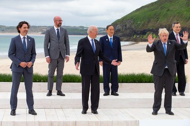 (L-R) Canadian Prime Minister Justin Trudeau, President of the European Council Charles Michel, US President Joe Biden, Japanese Prime Minister Yoshihide Suga, British Prime Minister Boris Johnson and Italian Prime Minister Mario Draghi pose for the Leaders official welcome and family photo during the G7 Summit In Carbis Bay, on June 11,