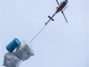 A helicopter lifts massive bags of marine debris from B.C.'s shoreline. Photo: Jeff Reynolds/Wilderness Tourism Association of B.C.
