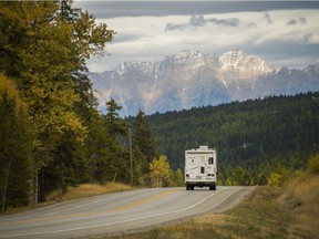 A camper on Highway 3 heading east towards the Steeples outside of Cranbrook.