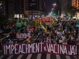 VIDEO ADDED: ct18AMGzEN4 A controversial Brazilian virologist says he will be teaching at BCIT. The B.C. post-secondary institution says that's not the case. A file photo taken in May shows a demonstration in Sao Paulo, Brazil, against President Jair Bolsonaro's handling of COVID-19.