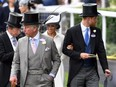 John Warren,, Prince Charles, Prince of Wales, Meghan, Duchess of Sussex and Prince Harry, Duke of Sussex attend the first day of Royal Ascot on June 19, 2018 in Ascot, England.
